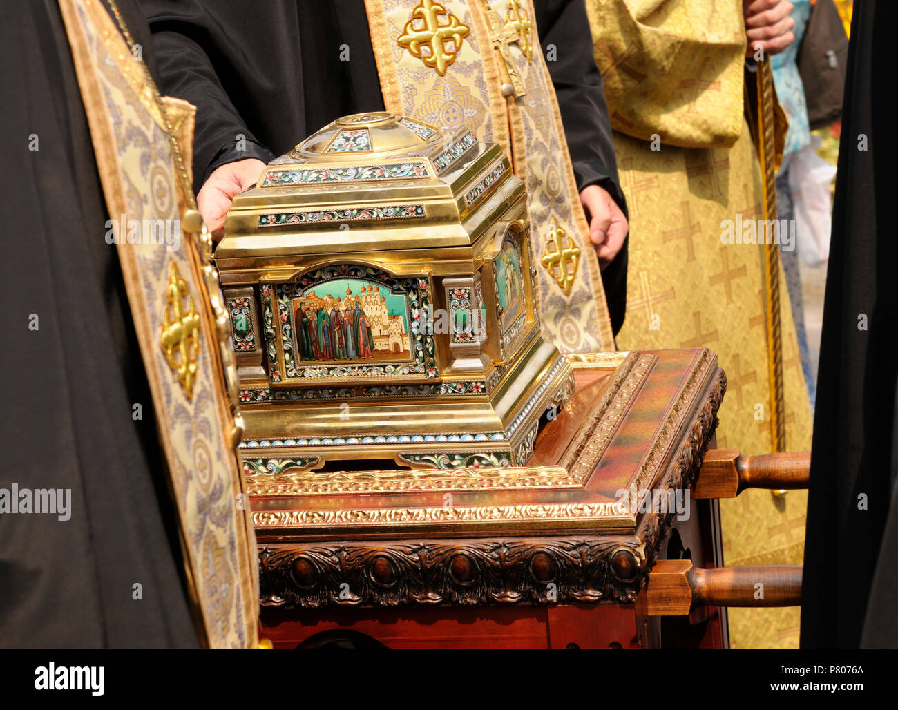 Orthodox churchmen bearing holy relic – the reliquary with hallows inside. Procession, the Day of Baptism of Rus. July 27, 2017. Kiev, Ukraine - Stock Image
