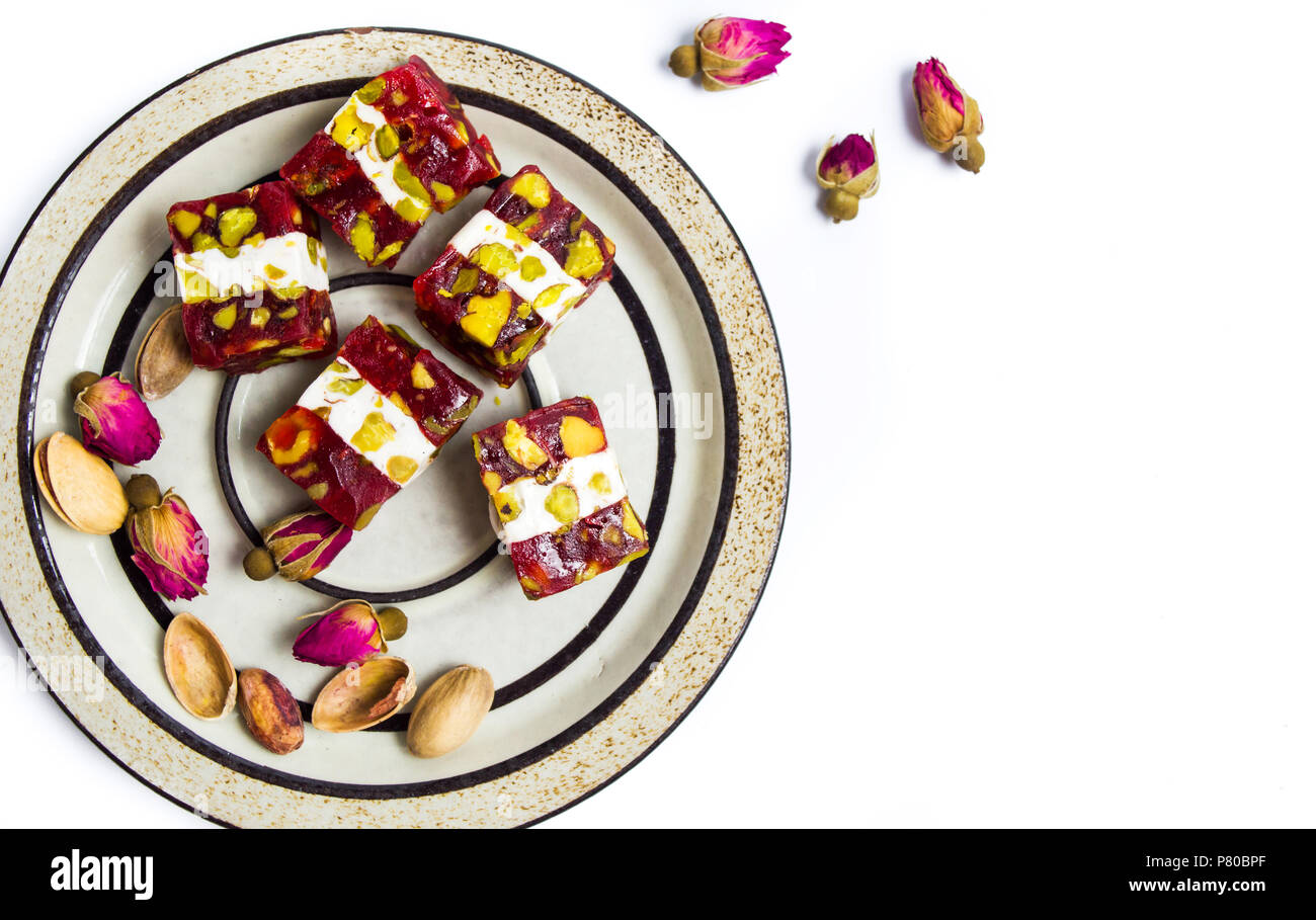 turkish delights with pistachios and rose flower - Stock Image