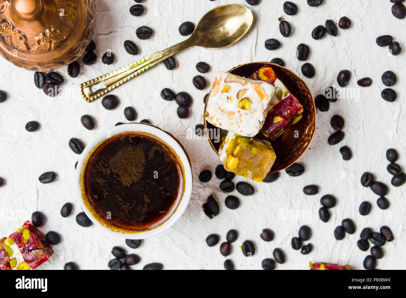 Turkish delights with roasted coffee beans top view - Stock Image
