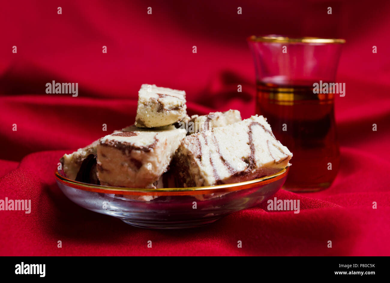 Halva with cacao served with tea on a plate - Stock Image
