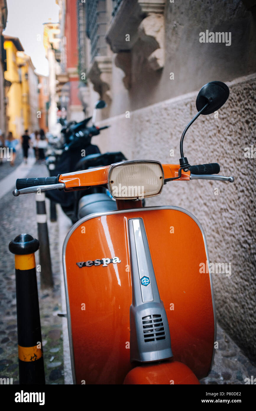 Classic Vespa scooter in an Italian backstreet - Stock Image