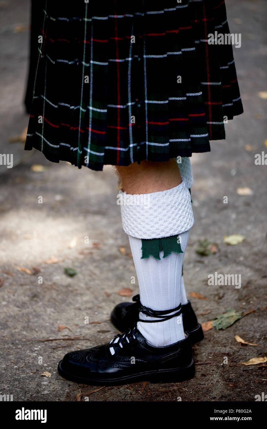 White socks and plaid Scottish kilt skirt. Culture - Stock Image