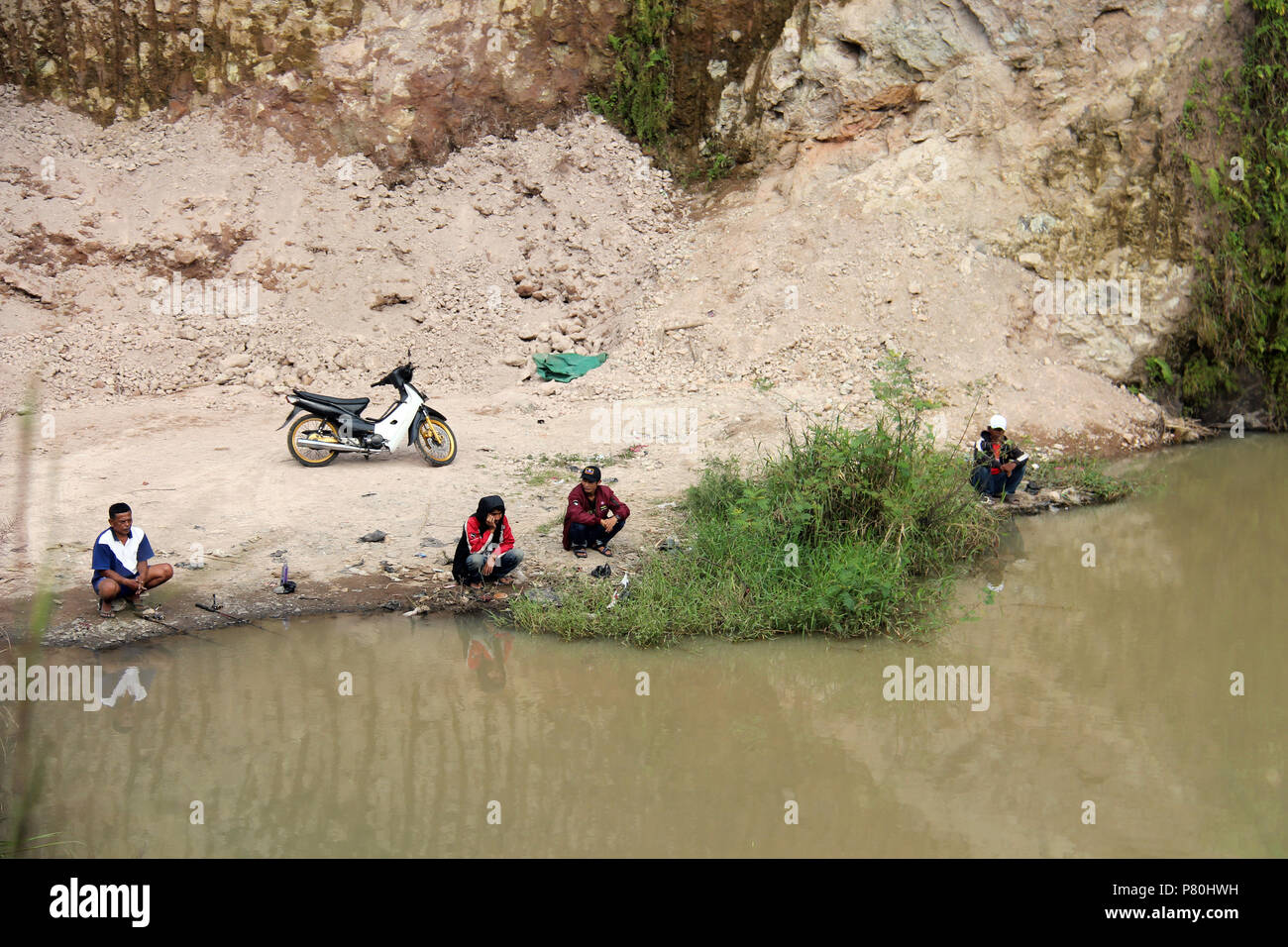 People fishing in  Bandung, Indonesia. - Stock Image