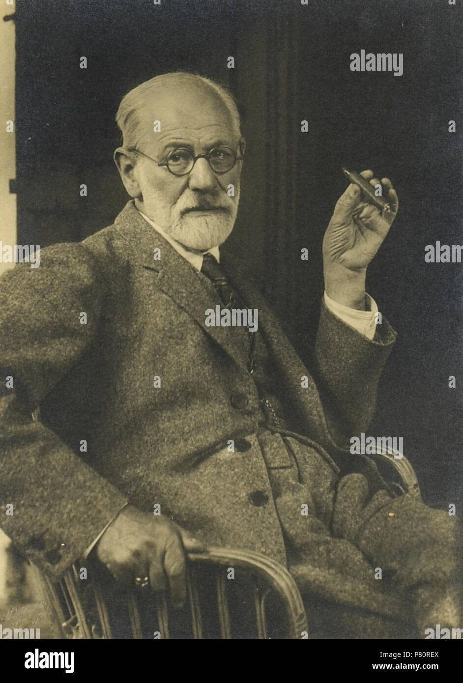 Silver gelatin print, 9 x 6½ inches, tipped to mount, photographer's blindstamp in lower left corner, being a portrait of a seated Sigmund Freud . circa 1921 346 Sigmund Freud by Max Halberstadt - Stock Image