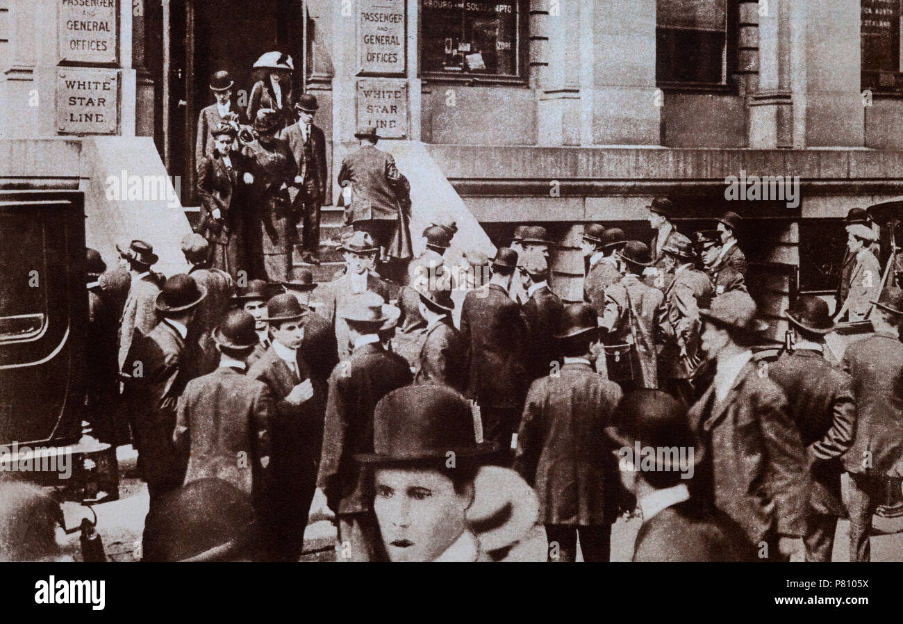 Following the sinking of the 'Titanic' in April 1912, relatives gather at the offices of the White Star Shipping Line offices at 30 James Street in Lindon, England. - Stock Image
