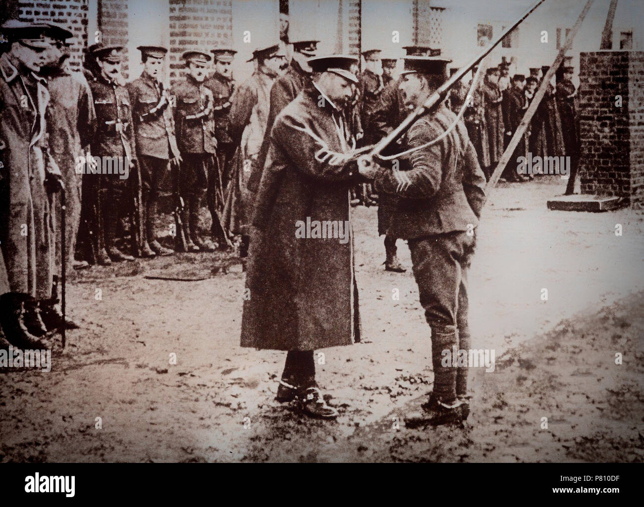 With the outbreak of World War 1, King George V crossed to France in November 1914 and spent several days with the troops. He decorated a soldier in the presence of Sir Douglas Haig, commander of the 1st Army Corps. - Stock Image