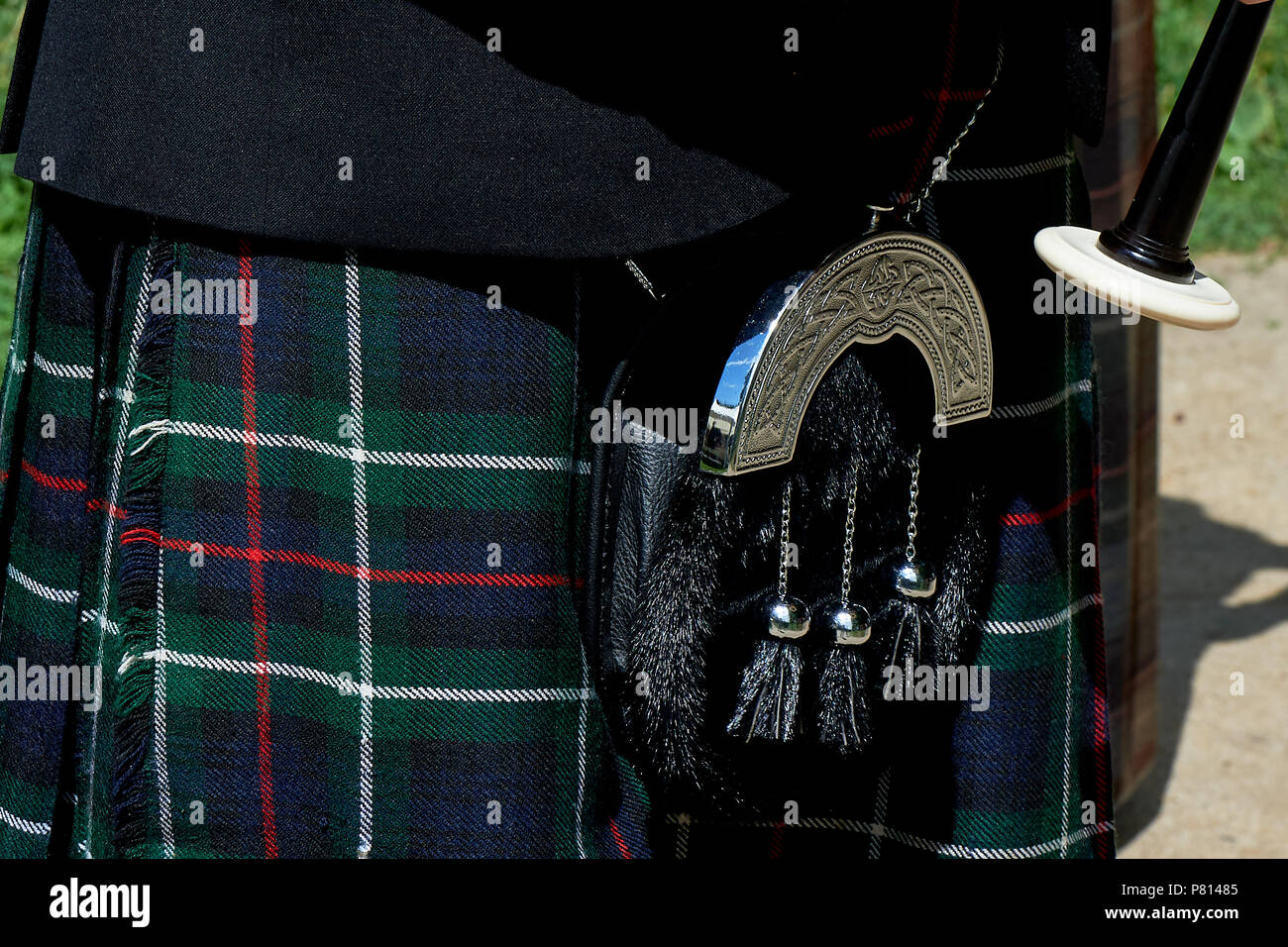 The details of the skirt of the kilt and the little bags with tassels.Closely - Stock Image