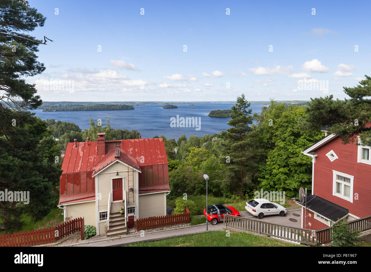 Scenic view of two old wooden houses at the Pispala district and Lake Pyhäjärvi from above in Tampere, Finland, on a sunny day in summer. Copy space. - Stock Image