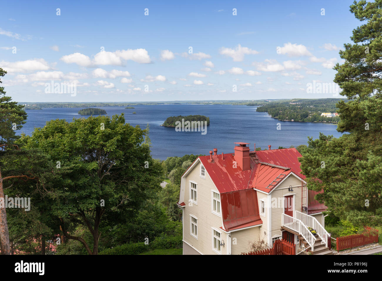 Scenic view of an old wooden house at the Pispala district and Lake Pyhäjärvi from above in Tampere, Finland, on a sunny day in summer. Copy space. - Stock Image