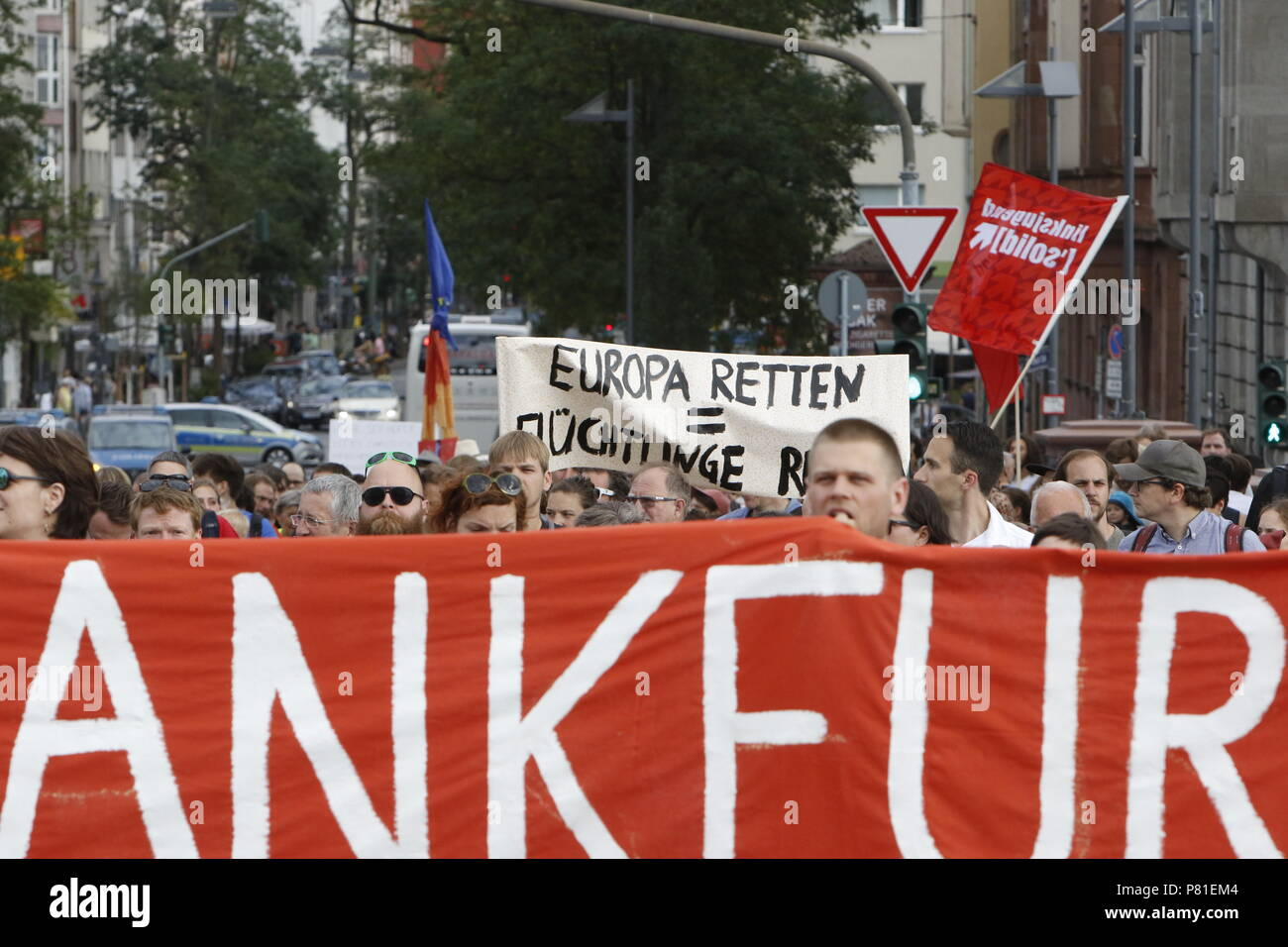 Frankfurt, Germany. 07th July, 2018. Protester march with banners and signs through Frankfurt. Around 800 protesters marched through Frankfurt to protest against the politics of the German government and the EU of closed borders and the prevention of sea rescue operations of NGOs, by grounding their ships in Malta, that causes refugees to drown in the Mediterranean. They called for the Mayor of Frankfurt to declare Frankfurt a safe haven city for refugees from the Mediterranean. The protest was part of the German wide Seebrucke (Sea bridge) protest that saw thousands of people protest in sever Stock Photo