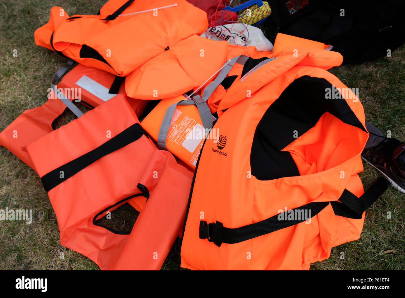 Frankfurt, Germany. 07th July, 2018. A pile of life jackets lie on the floor. Around 800 protesters marched through Frankfurt to protest against the politics of the German government and the EU of closed borders and the prevention of sea rescue operations of NGOs, by grounding their ships in Malta, that causes refugees to drown in the Mediterranean. They called for the Mayor of Frankfurt to declare Frankfurt a safe haven city for refugees from the Mediterranean. The protest was part of the German wide Seebrucke (Sea bridge) protest that saw thousands of people protest in several German cities. Stock Photo
