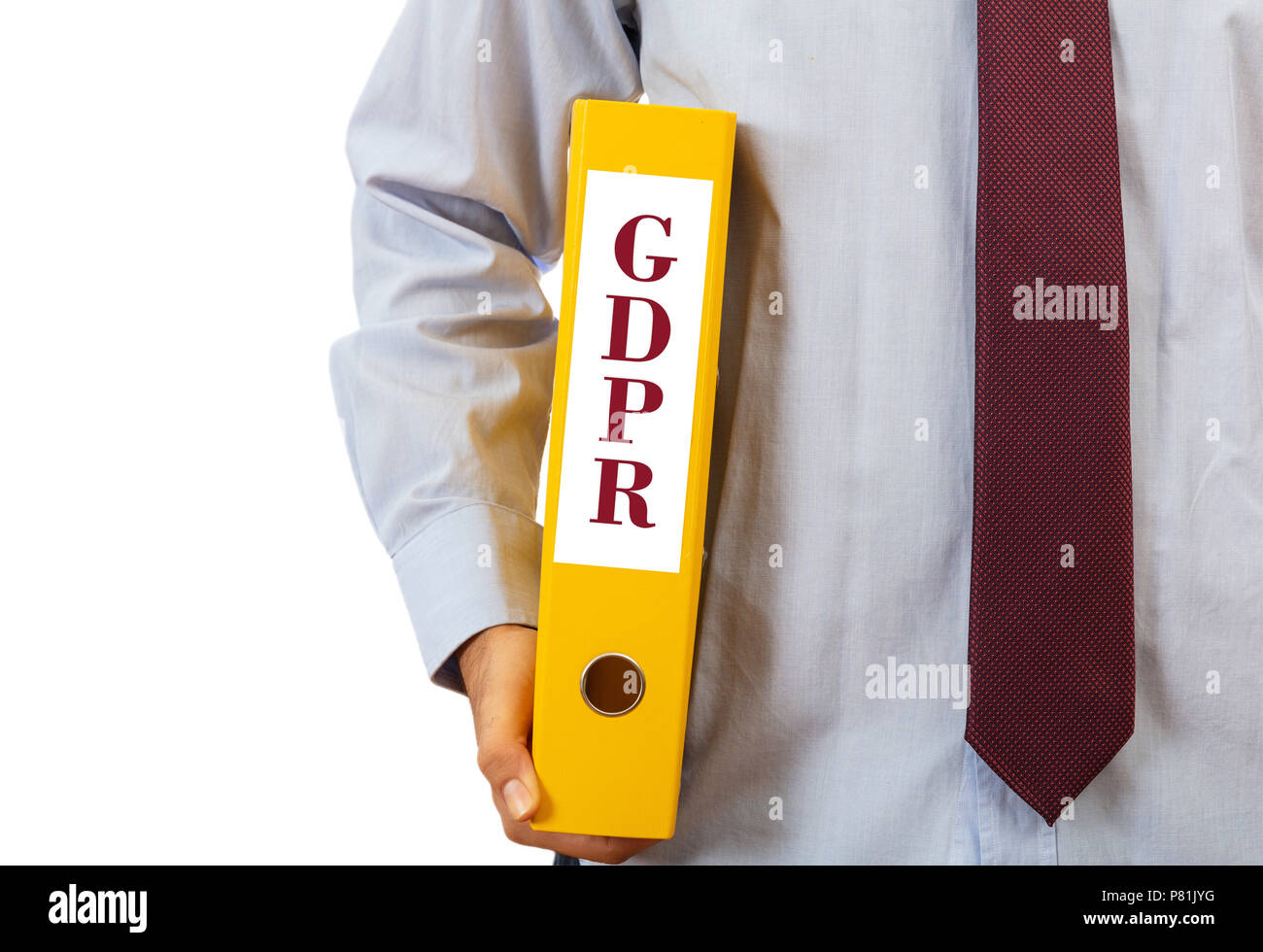 GDPR compliance. Manager holding a binder folder on white background, text GDPR, clipping path - Stock Image