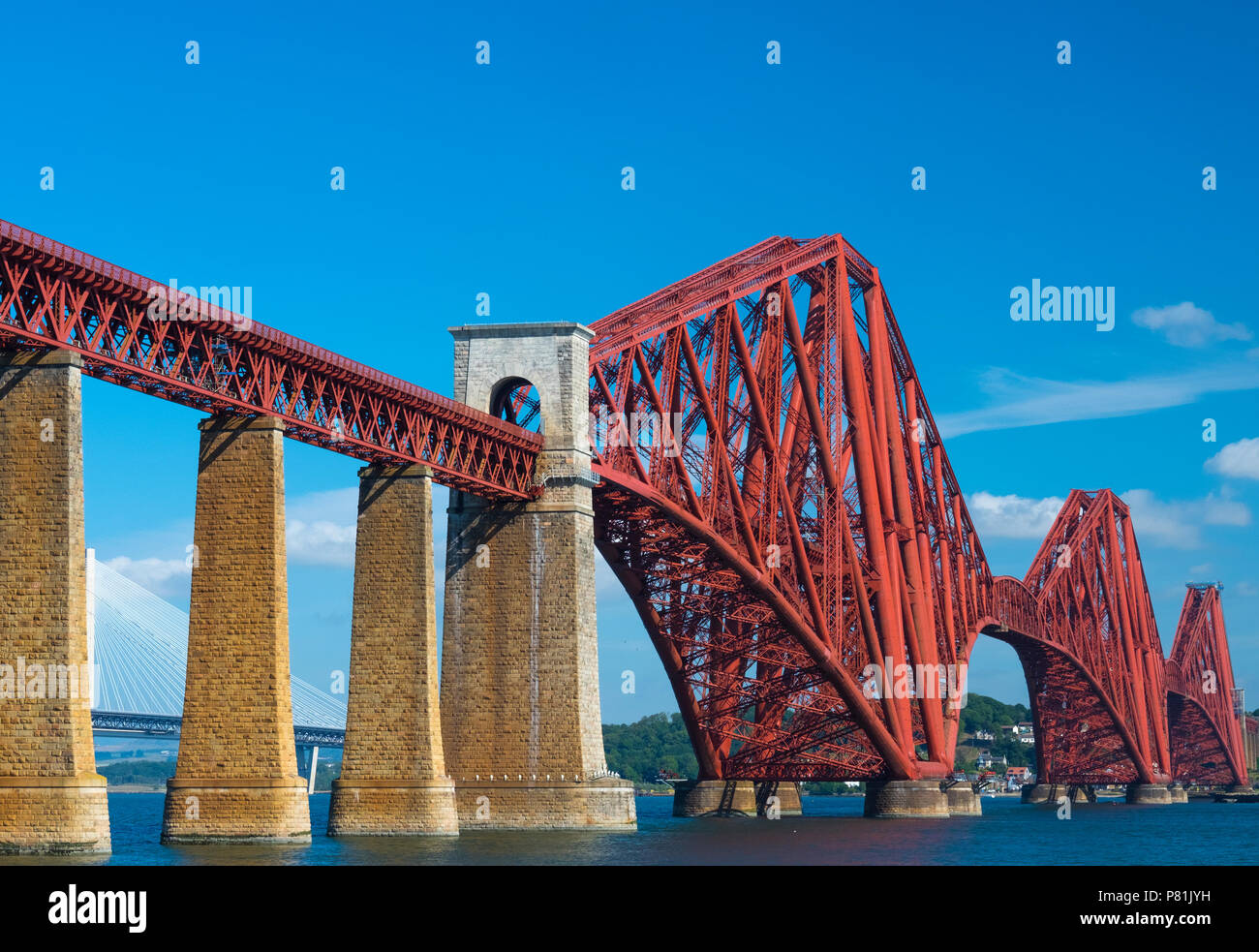 The iconic Forth Bridge spans the Firth of Forth, connecting Queensferry and North Queensferry, summer 2018. Stock Photo