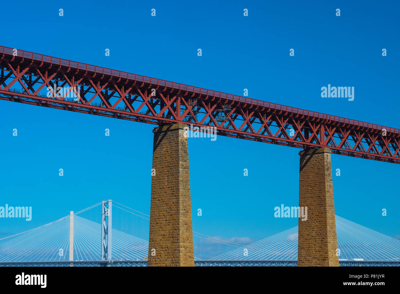 The  Forth (rail) Bridge with the Forth Road Bridge and Queensferry Crossing in the background,  summer 2018. Stock Photo