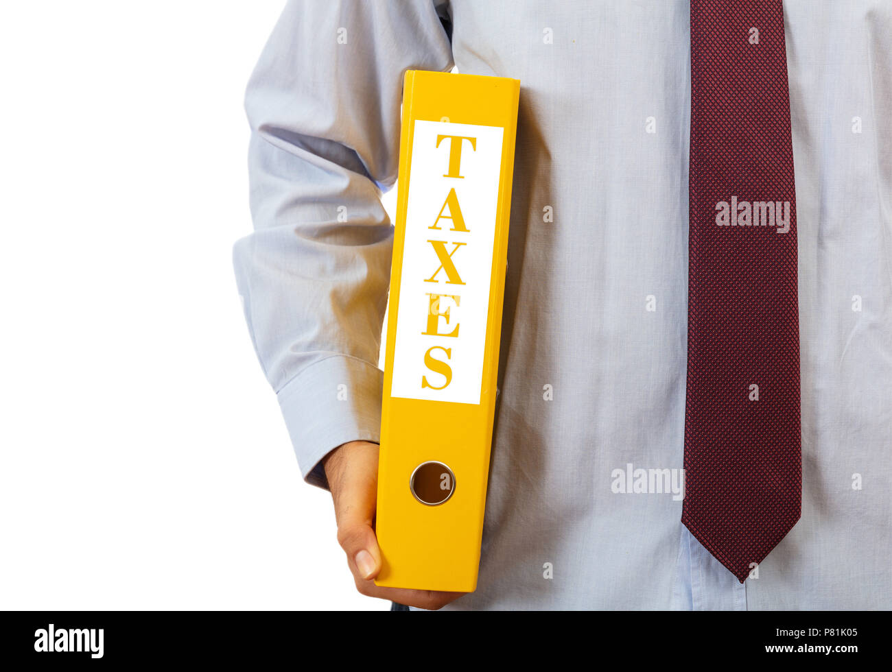 Business taxation. Manager holding a binder folder on white background, text taxes, clipping path - Stock Image