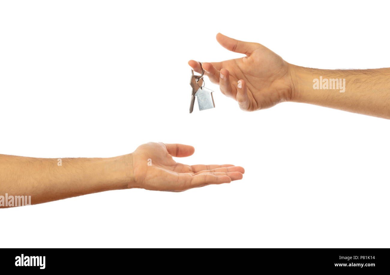 Handing over the house key. Male hands isolated on white background, clipping path - Stock Image