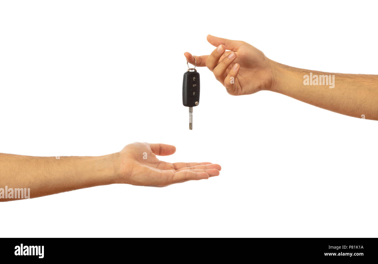Handing over the car key. Male hands isolated on white background, clipping path - Stock Image