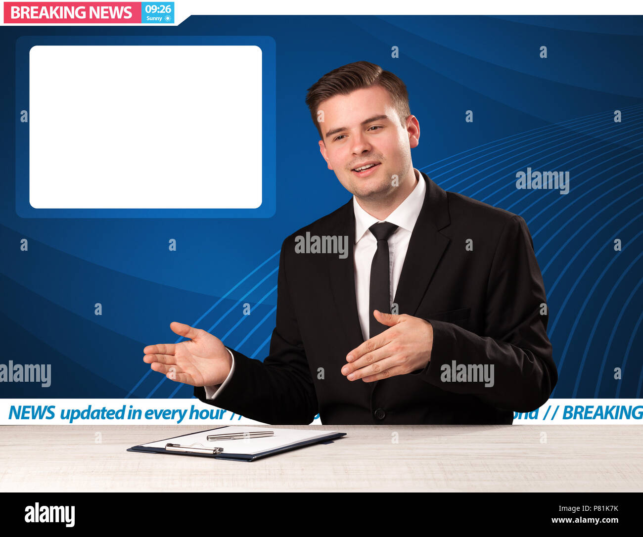Television reporter telling breaking news at his studio desk with copy space concept - Stock Image