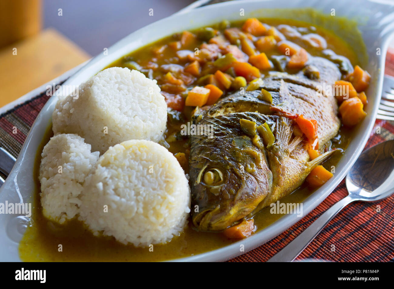 Fish Stew, Tilapia Ugandan (Ngege), with Carrots Tomatoes Onions Green Peppers, served with Rice, Dining in Uganda Food, Africa - Stock Image