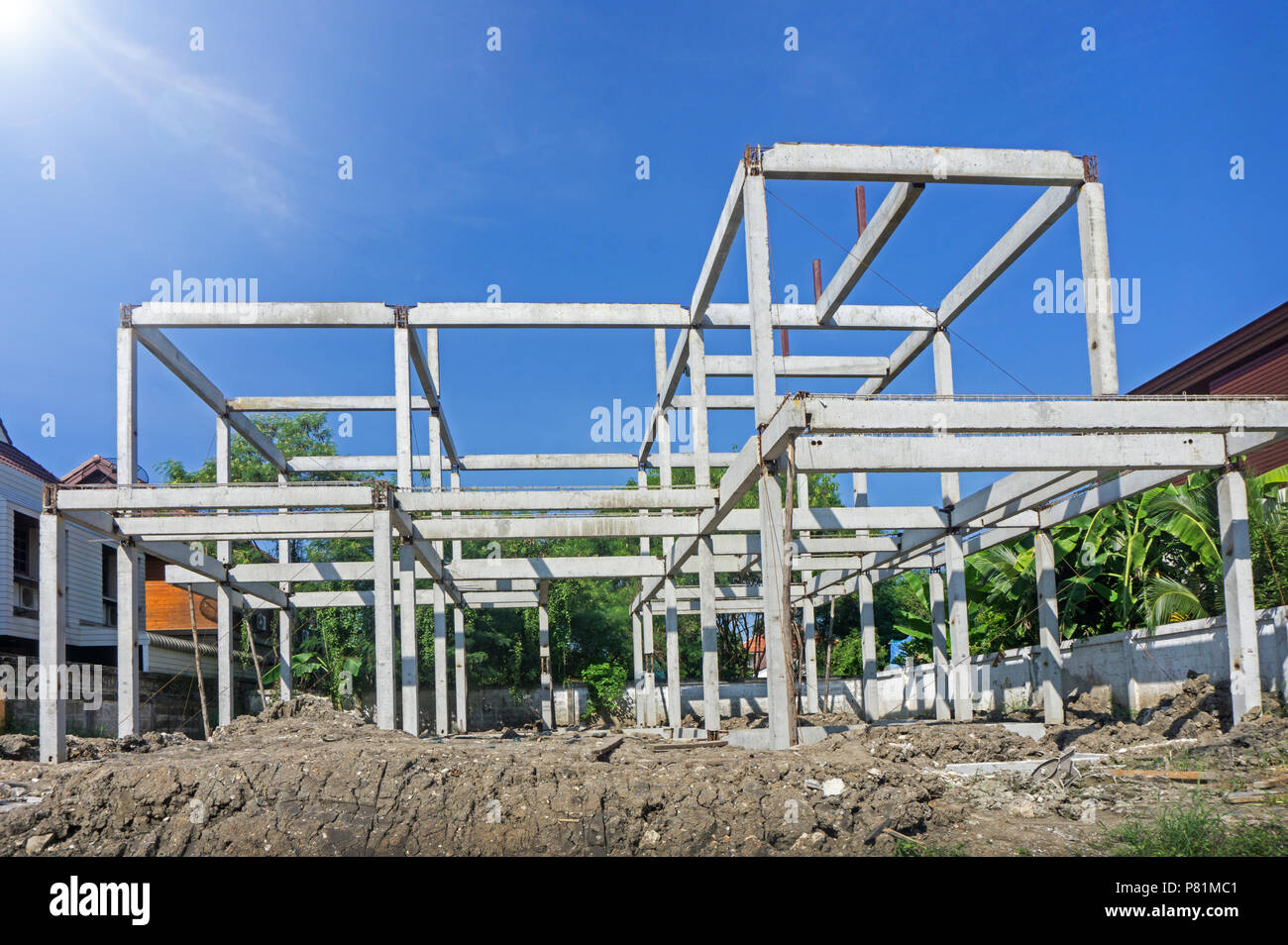 New residential construction home concrete framing against a blue sky