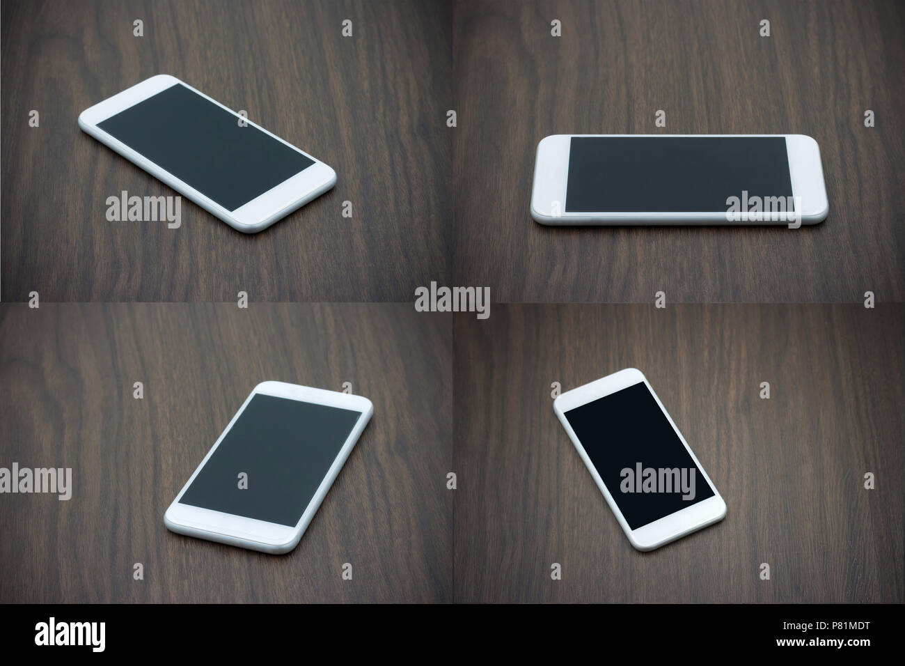 Smart phone in white color with blank screen laying on wooden table