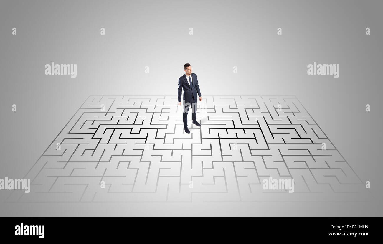 Elegant businessman looking for a solution in a middle of a maze   - Stock Image