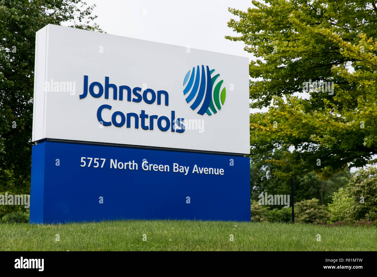 A logo sign outside of the headquarters of Johnson Controls