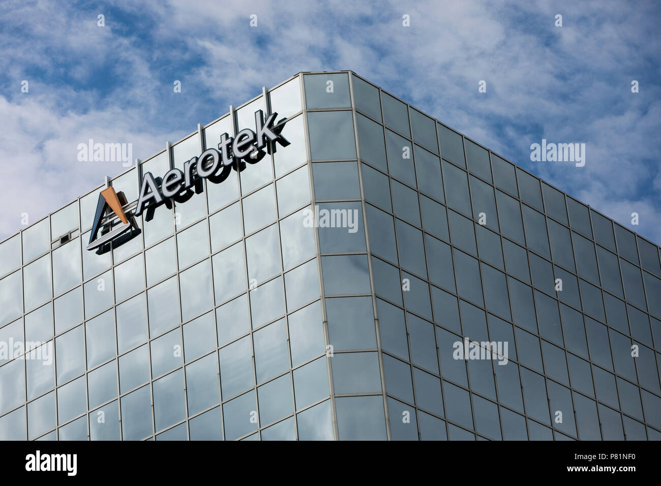 A Logo Sign Outside Of An Office Building Occupied By Aerotek In