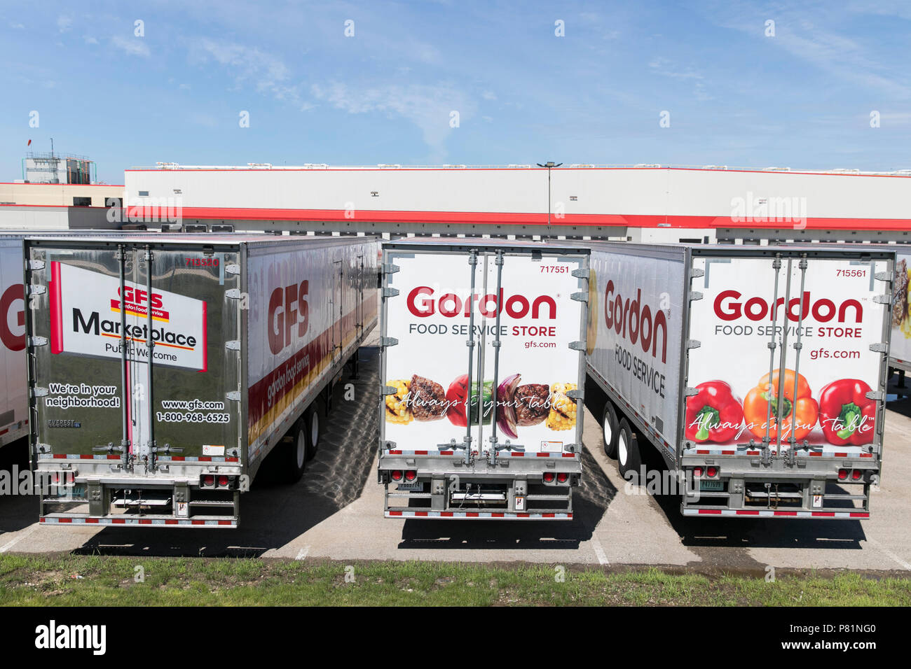 Semi trucks and trailers featuring Gordon Food Service logos outside