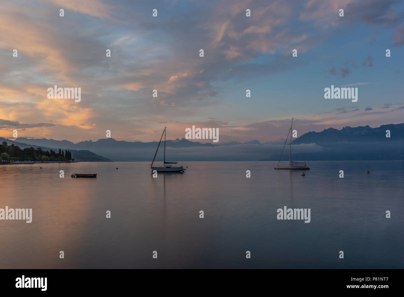 Colorful sunrise on the marina of Lausanne on the Lake Leman in summer with the view of the Swiss Alps in background - 17 - Stock Image