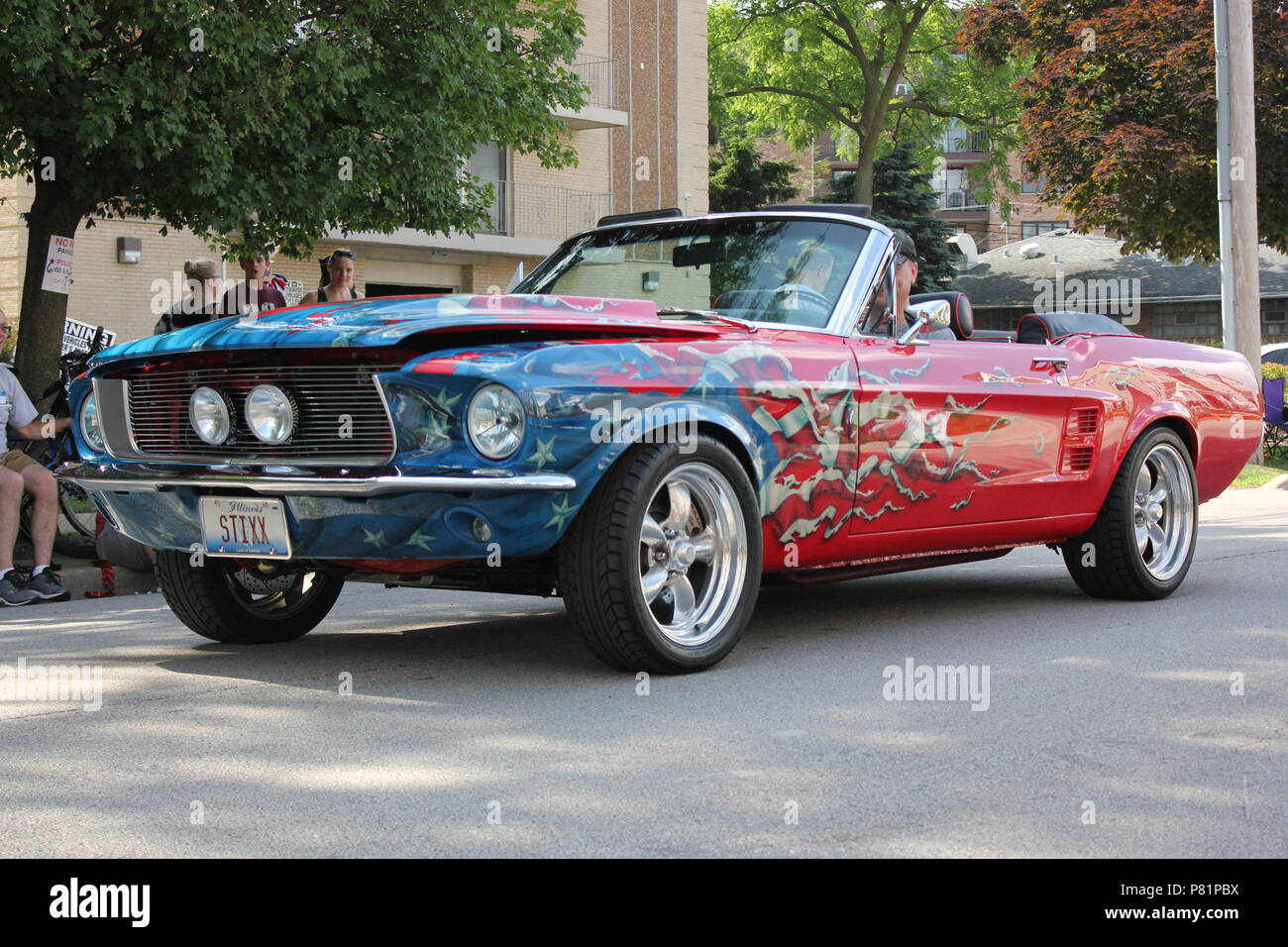 b1bc39de5 Red White and Blue Ford Mustang convertible with a custom paint job  parading in the Fourth