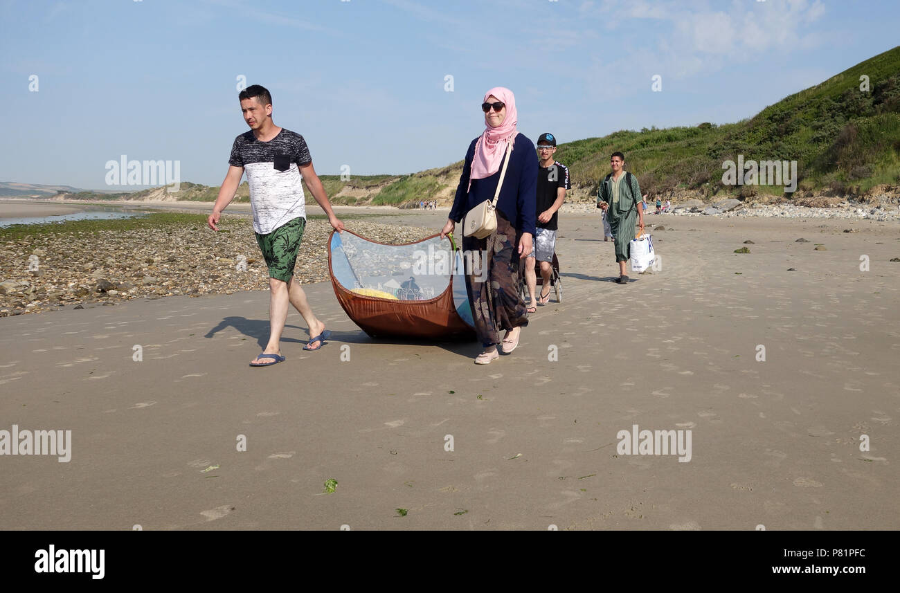 Muslim family on the seaside beach in northern France  Pas-de-Calais department in the Hauts-de-France region of France. - Stock Image