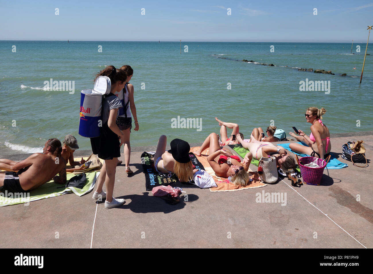 Promotion girls handing out complimentary Red Bull drinks at Wimereux in the Pas-de-Calais department in the Hauts-de-France region of France. - Stock Image