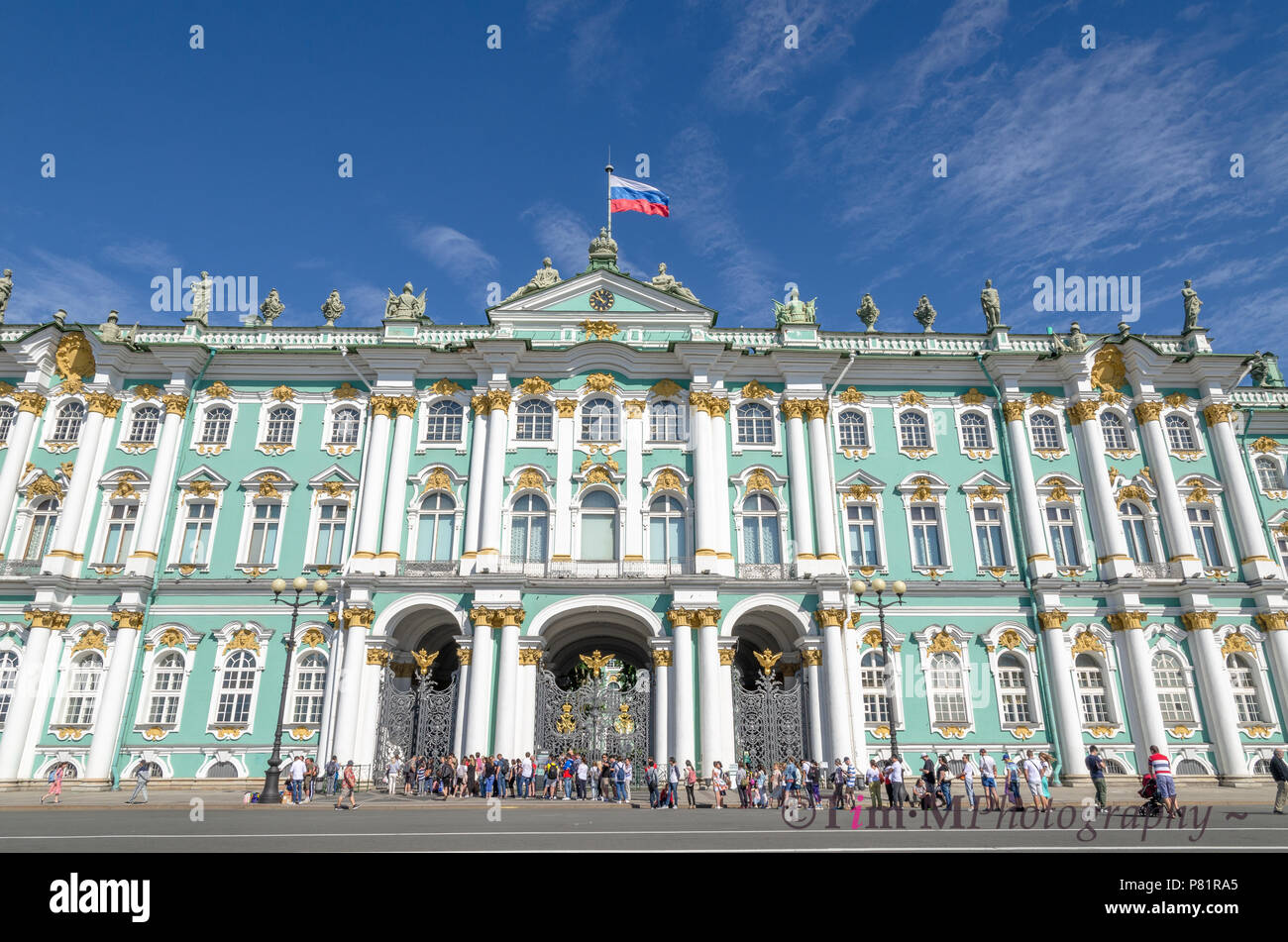 Tourists queuing to enter the Winter Palace and State Hermitage Museum in St Petersburg - Stock Image