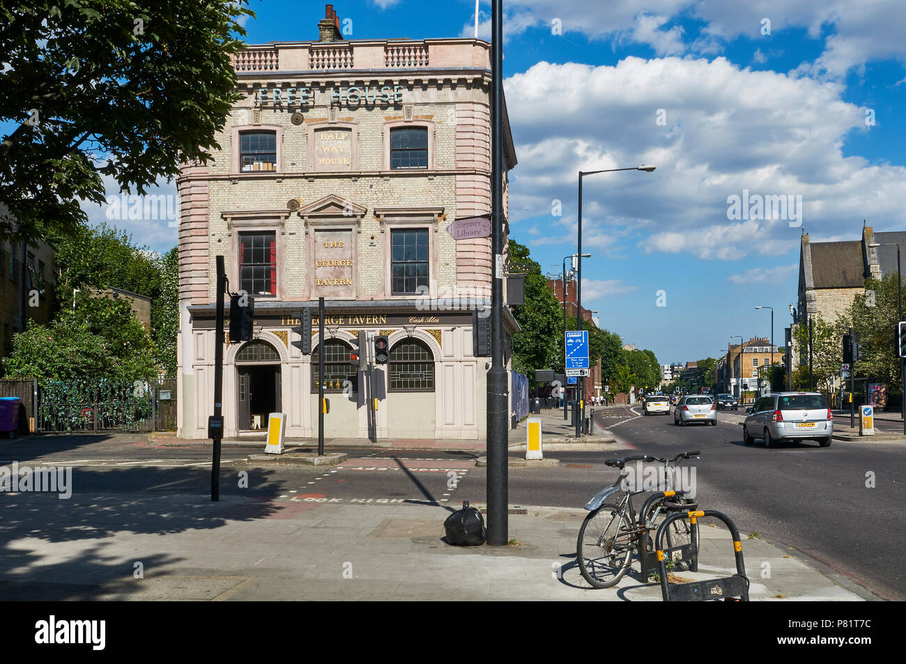 The historic George Tavern pub on Commercial Road, Stepney, East London UK, with Jubilee Street in foreground - Stock Image
