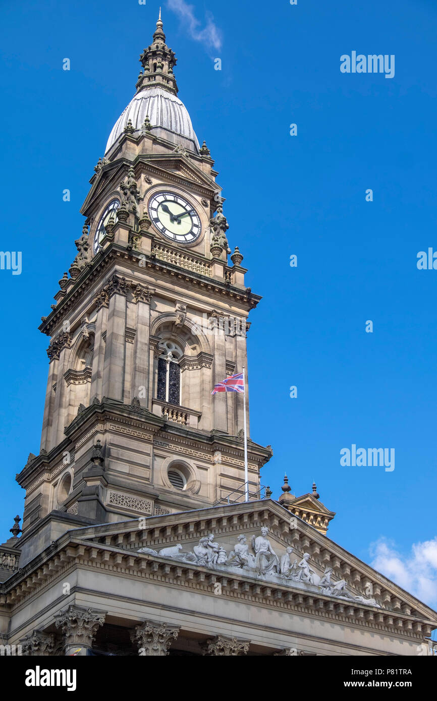 Clock tower of bolton town hall with blue sky Stock Photo