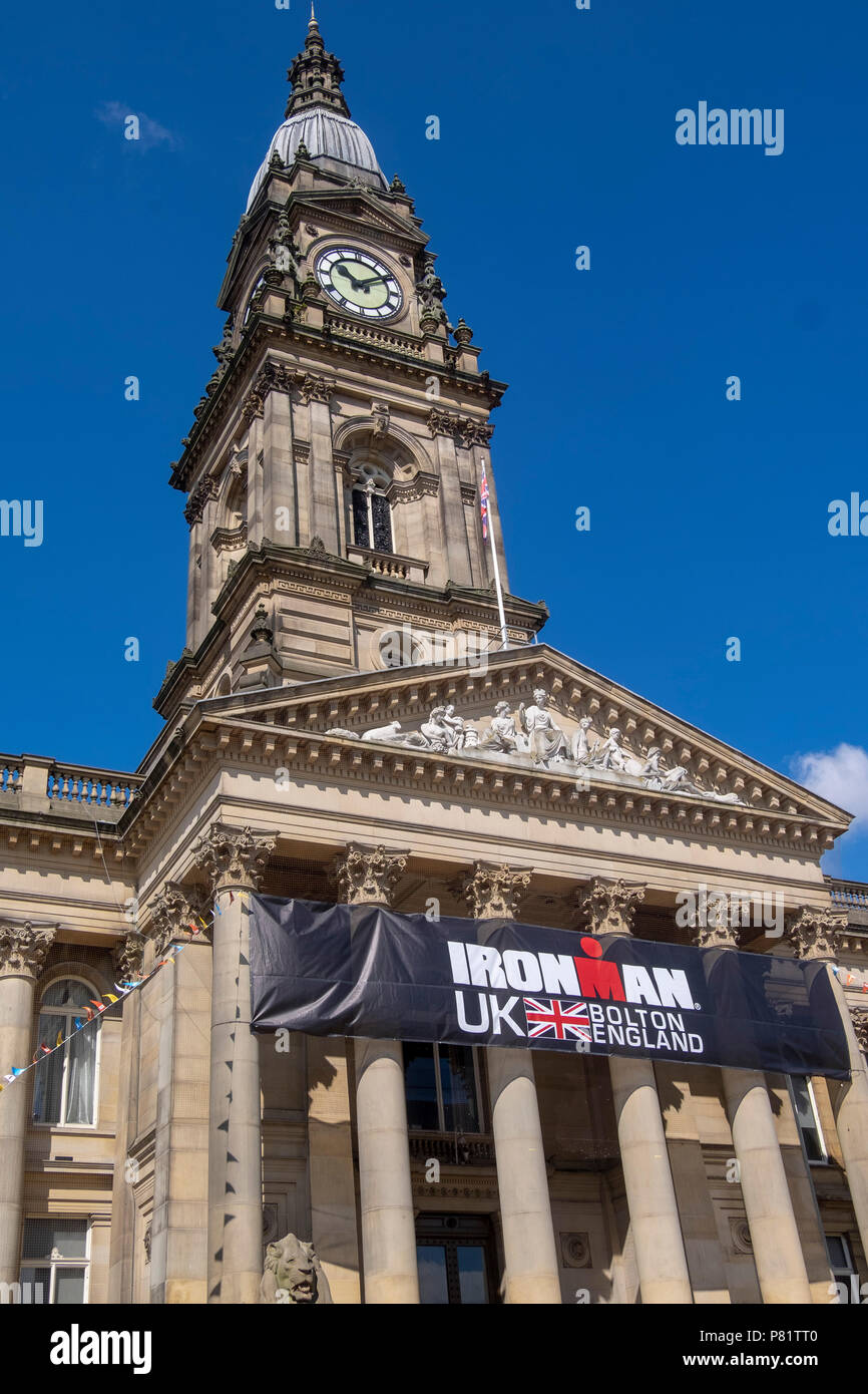 Clock tower of bolton town hall with blue sky - Stock Image