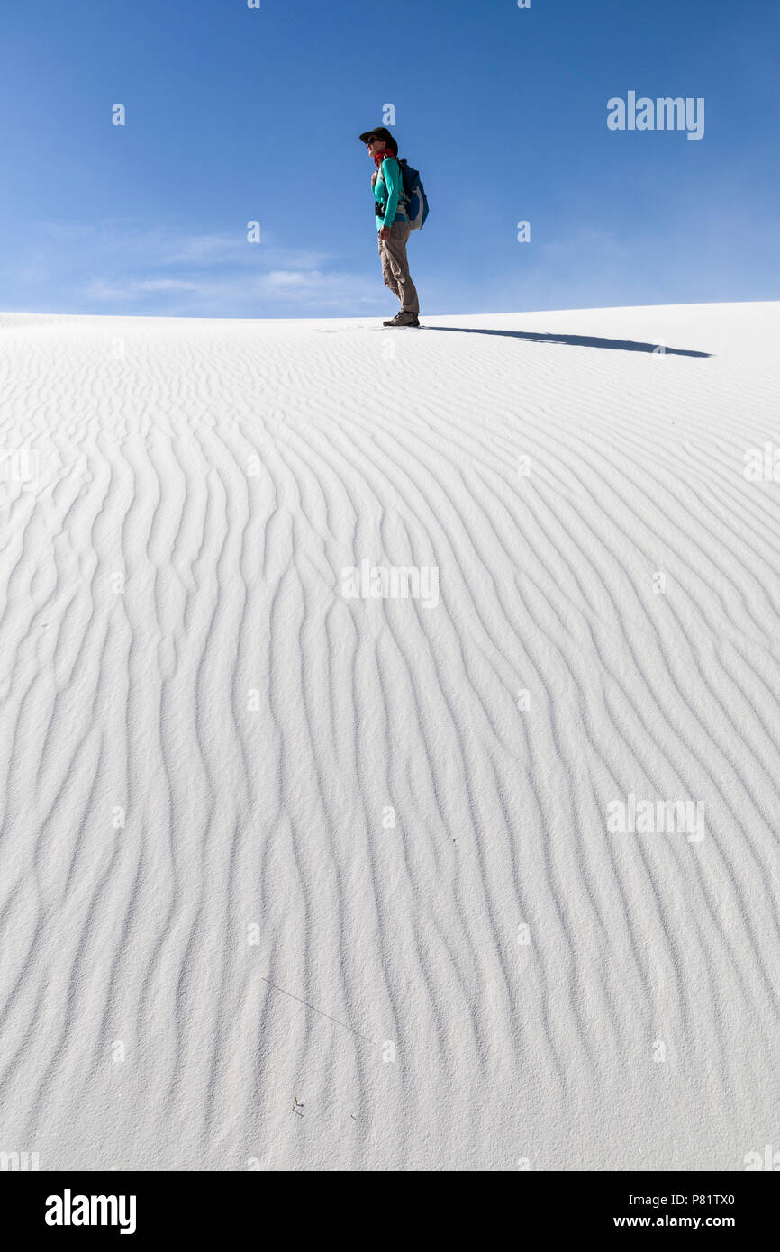 Walker on dume at White Sands, New Mexico, USA - Stock Image