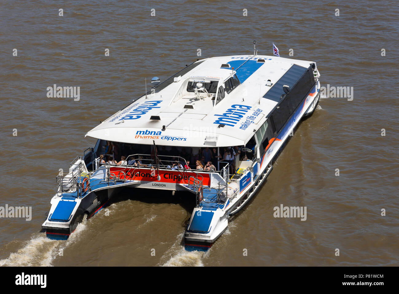 MBNA Thames clipper river bus services on River Thames at South Bank, London Borough of Lambeth, Greater London, England, United Kingdom - Stock Image