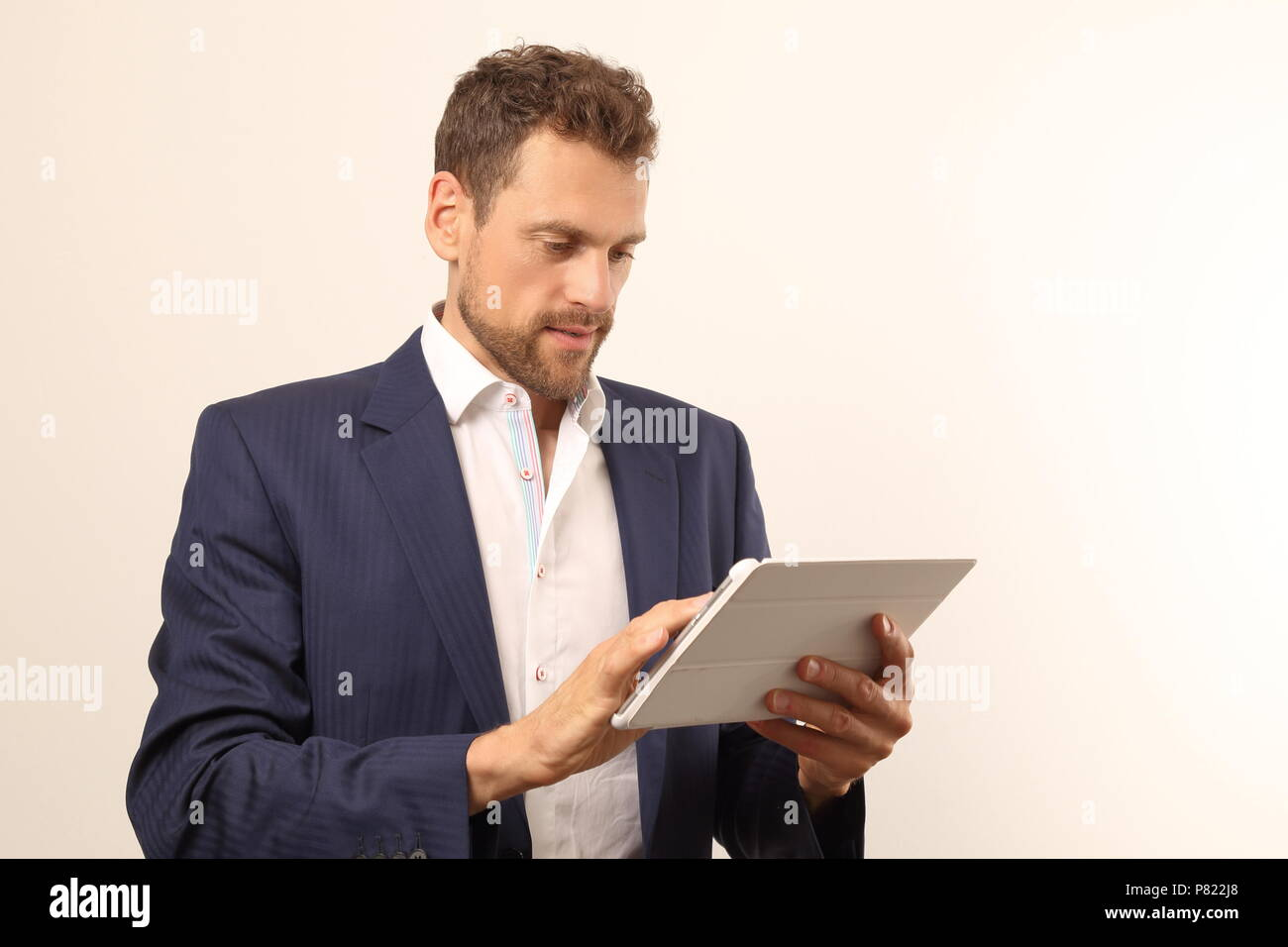 A Modern business man with tablet PC - Stock Image