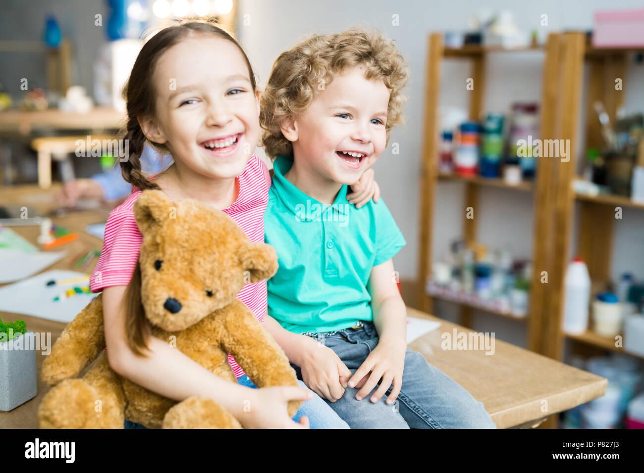 Happy Kids with Teddy Bear - Stock Image