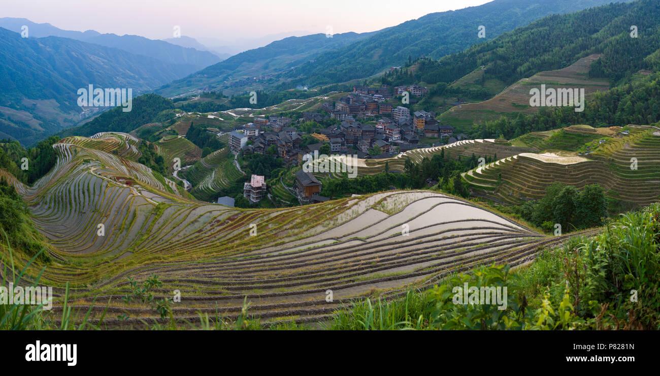 Longji Rice Terrace - Dragon's Backbone - at sunset Stock Photo