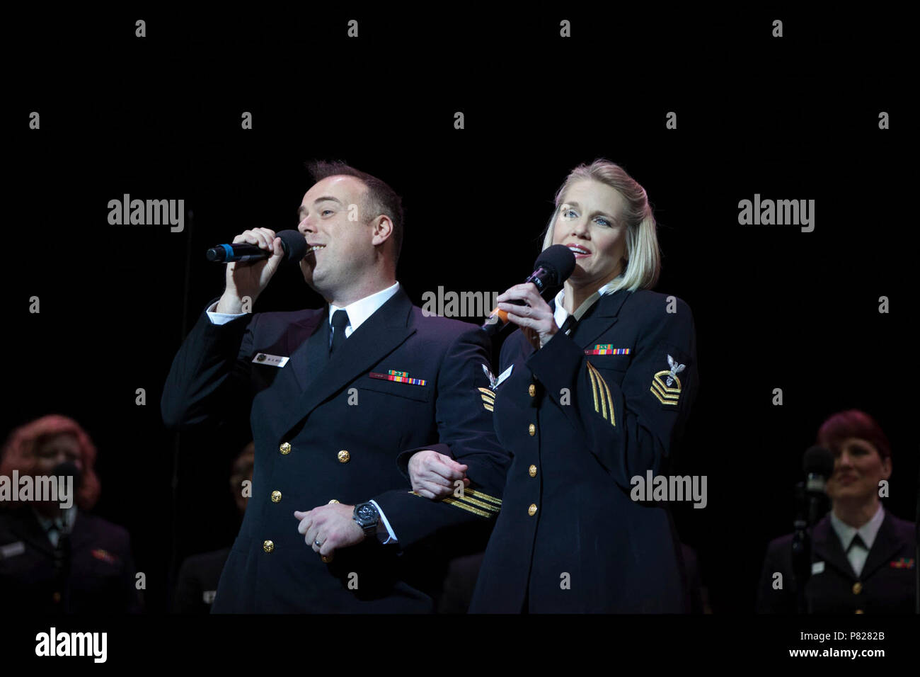 ALBANY N.Y. (April 11, 2016) Chief Musician Beth Revell and Musician 1st Class Michael Webb perform a duet with the Sea Chanters chorus. The Sea Chanters are on a 22-day tour of the northeastern United States. - Stock Image