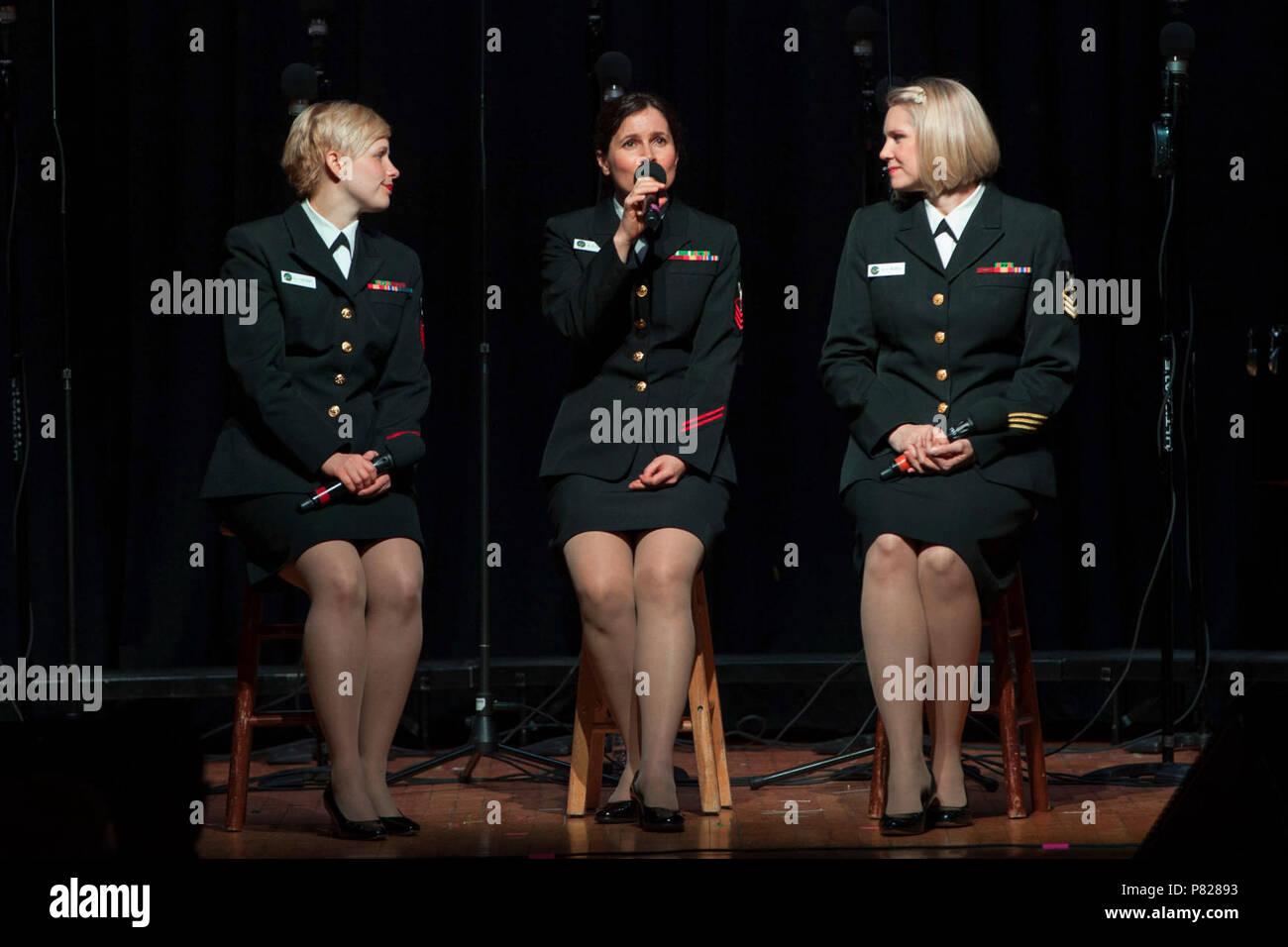 PHILLIPSBURG, N.J. (April 22, 2016) From left to right, Musician 1st Class Sarah Tietsort and Chief Musicians Antje Farmer and Beth Revell perform a trio during a concert at Phillipsburg High School. The Sea Chanters are finishing up a 22-day tour of the northeastern United States. - Stock Image