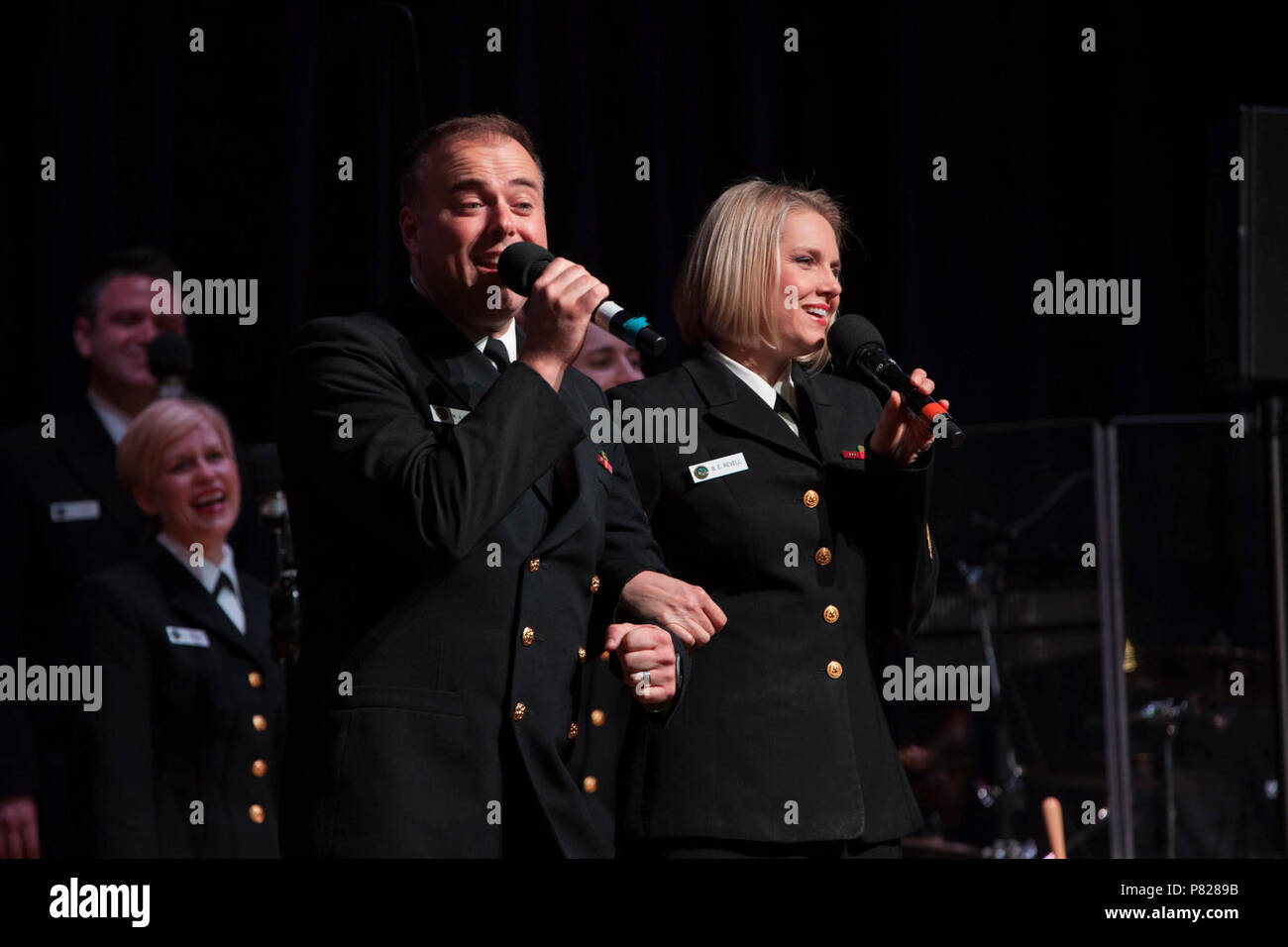 PHILLIPSBURG, N.J. (April 22, 2016) Musician 1st Class Michael Webb and Chief Musician Beth Revell sing the Sonny and Cher tune, 'I Got You Babe' as part of a medley of hits from the 1960s. The Sea Chanters are finishing up a 22-day tour of the northeastern United States. - Stock Image