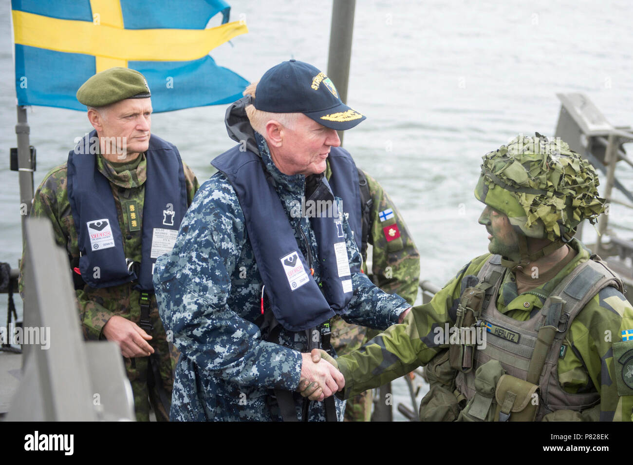 BUSO, Finland (June 8, 2016) - Vice Admiral James Foggo III, commander, Naval Striking and Support Forces NATO, and commander, U.S. 6th Fleet shakes hands with a member of the Swedish Marines during BALTOPS 2016.  BALTOPS is an annual recurring multinational exercise designed to improve interoperability, enhance flexibility and demonstrate the resolve of allied and partner nations to defend the Baltic region. Stock Photo
