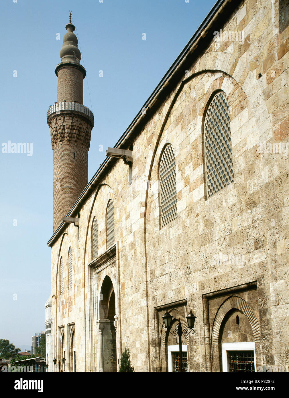 Turkey. Asia Minor. Bursa. Grand Mosque of Bursa (Ulu Camii). It was built in Seljuk style between 1396-1399. Its construction was ordered by the Ottoman Sultan Bayesid I. Facade and minaret. - Stock Image