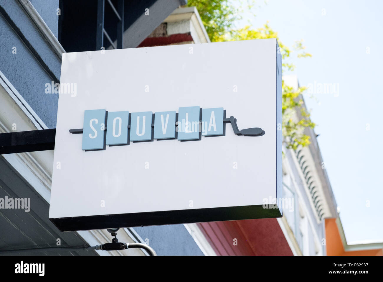 Exterior sign at Souvla, a group of fast-fine Greek restaurants in San Francisco, CA, USA. - Stock Image