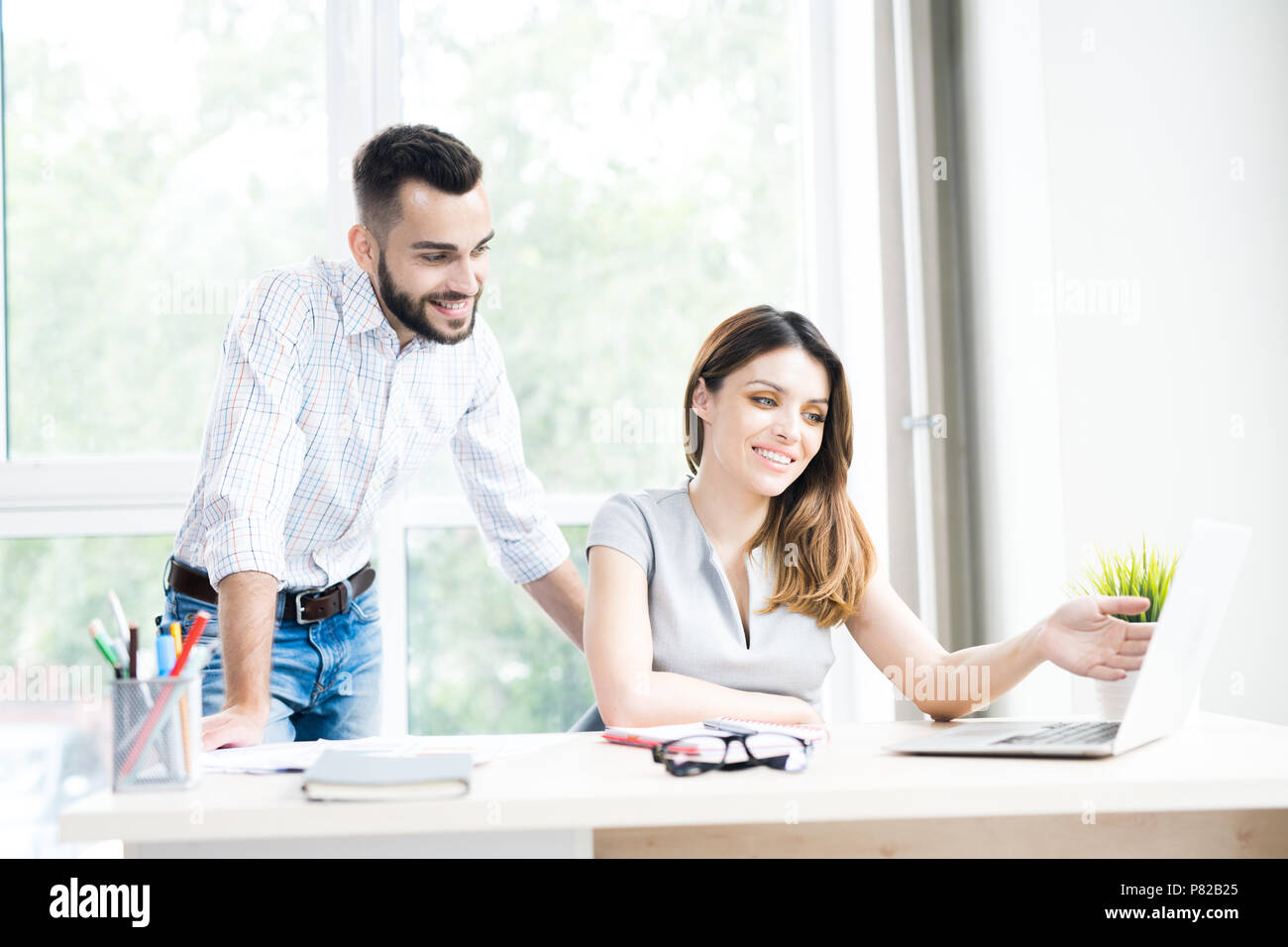 Two Modern Business People in Office - Stock Image