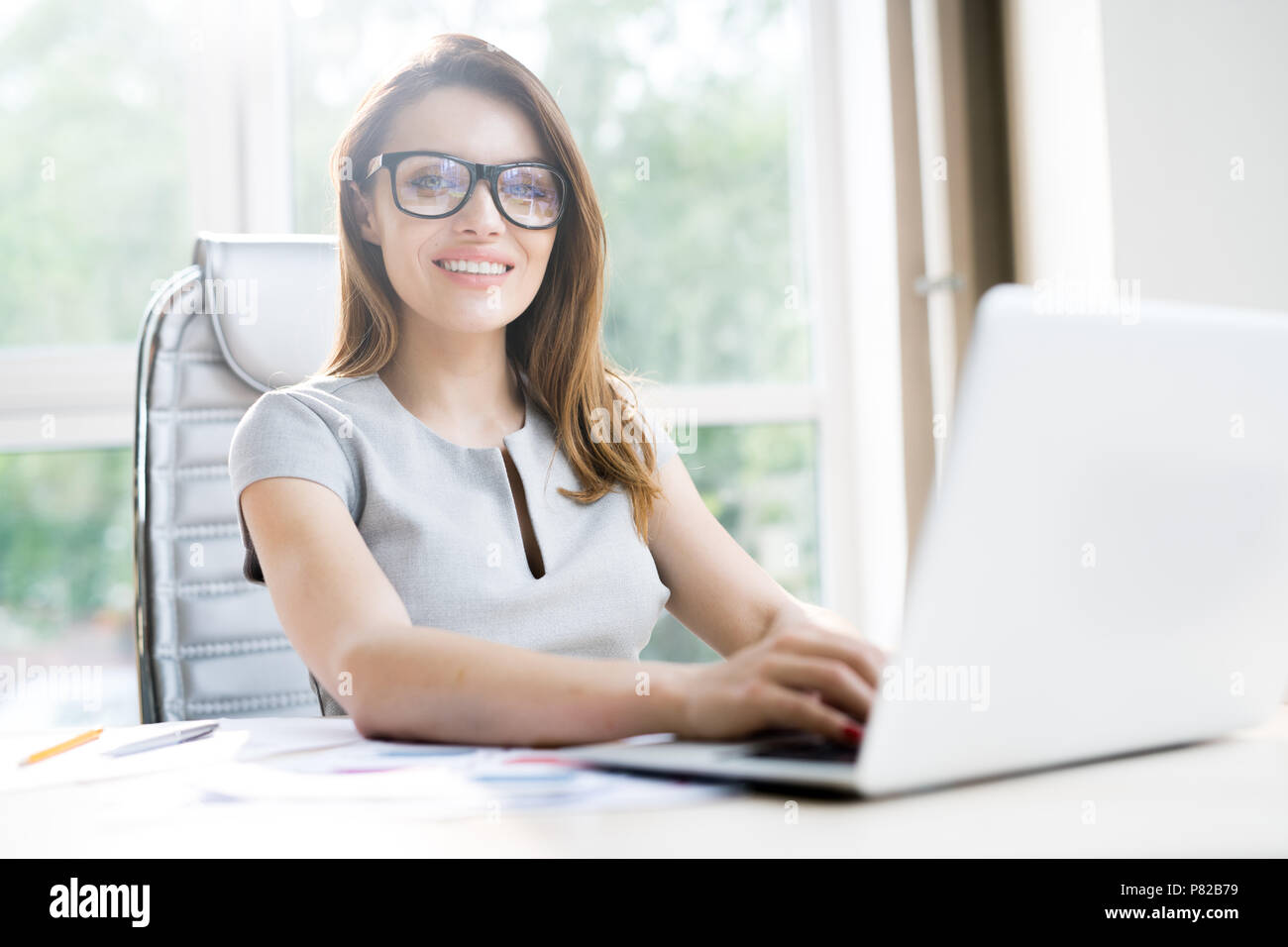 Young Businesswoman Using Laptop - Stock Image